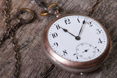 Old pocket watch on a chain — 图库照片