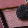 Stock Photo: Eyeshadow in pink tones and applicator close-up.
