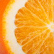 Sliced orange closeup isolated on white background. — Stock Photo #39357675