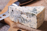 Blue cheese close-up on a kitchen wooden board — Stock Photo