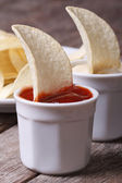Potato chips with ketchup and white sauce macro — Stock Photo