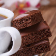Cup of coffee and aerated chocolate. macro vertical — Stock Photo #39888019