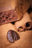 Coffee bean in the ground coffee on a background of chocolate — Photo