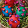 Painted Easter eggs decorated with flowers with pearls — Stock Photo #40830467