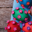 Easter eggs decorated with flowers on old table — Stock Photo #40830583