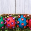 Easter eggs decorated with flowers closeup — Stock Photo #40830943