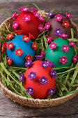 Painted Easter eggs decorated with flowers with pearls — Stock Photo