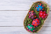 Easter eggs decorated with flowers top view — Stock Photo