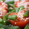 Green beans, cherry tomatoes and sesame seeds close-up — Stock Photo #40871733