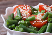 Green beans, cherry tomatoes and sesame seeds macro — Stock Photo