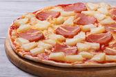 Juicy Hawaiian pizza with pineapple and ham — Stock Photo