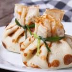Two beautiful delicious pancake on white plate closeup — Stock Photo #41819181