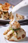 Sour cream pouring pancake on bag — Stock Photo