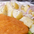 Stock Photo: Schnitzel with young boiled potatoes vertical macro