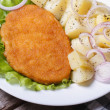 Schnitzel with young boiled potatoes top view — Stock Photo