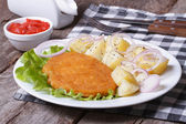 Schnitzel with young boiled potatoes  — Stock Photo