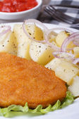 Schnitzel with young boiled potatoes vertical macro — Stock Photo