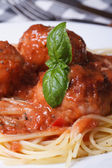Spaghetti with meatballs and tomato sauce vertical. Macro — Stock Photo