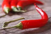 Red chili pepper on the table macro — Foto de Stock