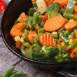 Steamed vegetables in a pan top view — Stock Photo