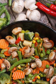 Fried mushrooms with vegetables in a pan vertical — Foto de Stock