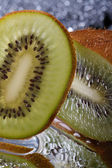 Chopped fresh kiwi fruit vertical. macro  — Stock Photo