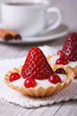 Tartlets with strawberries, cranberries and cream vertical — Stock Photo