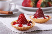 Two delicious fresh strawberry tarts horizontal. close-up — Stock Photo