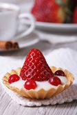 Tartlet with fresh strawberries, cranberries vertical. close-up  — Stock Photo
