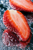 Two half fresh strawberries with water macro — Stock Photo