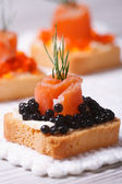 Canapes with black sturgeon caviar, smoked salmon and dill — Stock Photo