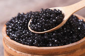 Spoon with black sturgeon caviar macro. — Stock Photo