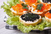 Sandwiches with red and black fish caviar  — Photo