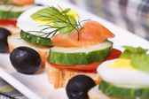 Canapes with salmon, cucumber, tomato and dill — Stock Photo