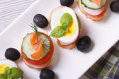 Various banquet canape with salmon, eggs, vegetables. macro — Stock Photo