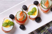 Various banquet canape with salmon, eggs top view — Stock Photo