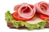 Beautiful sandwich with ham and vegetables isolated — Stock Photo