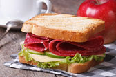 Breakfast: toast with salami, coffee, red apple — Stock Photo