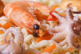 Mollusks and shrimps and Chinese noodles soup close up — Stock Photo