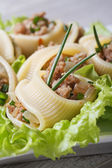 Pasta lumakoni stuffed meat vertical macro  — Stock Photo