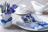 Elegant spring table setting with flowers muscari — Stock Photo
