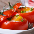 Tasty appetizer of baked tomatoes stuffed with eggs — Stock Photo #46184835