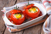 Baked tomatoes stuffed with egg — Stock Photo