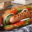 A quick lunch: a hot dog and apple — Stock Photo