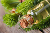 Fir aromatic oil in a glass bottle. macro horizontal — Stock Photo
