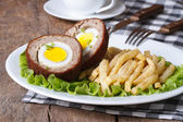 Meat stuffed with egg and French fries close-up — Stock Photo