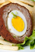 Meat stuffed eggs with french fries and lettuce macro — Stock Photo