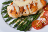Grilled chicken breast with asparagus, macro. — Stock Photo