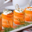 Appetizer of fresh carrot rolls with cream cheese — Stock Photo #47408209