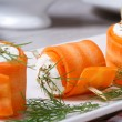 Rolls of fresh carrots with cheese and dill macro — Stock Photo #47408829